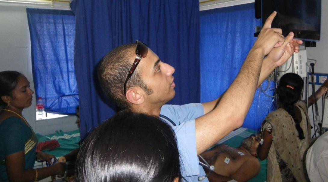 Local dentist shows a Dentistry intern an x-ray of a patient in India.